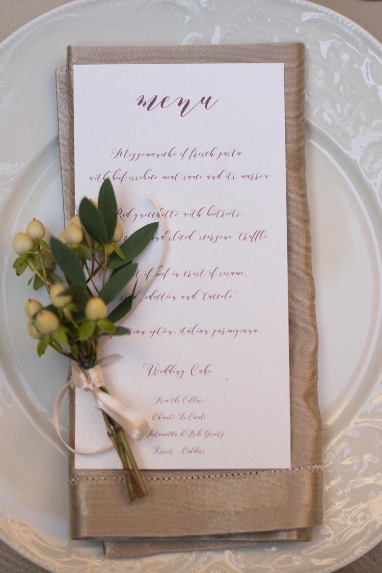 Reception Table Setting Menu Calligraphy Metallic Napkin Fresh Greenery Patterned Plate Romantic Outdoor Castle Tuscany Wedding http://www.natalymontanari.com/