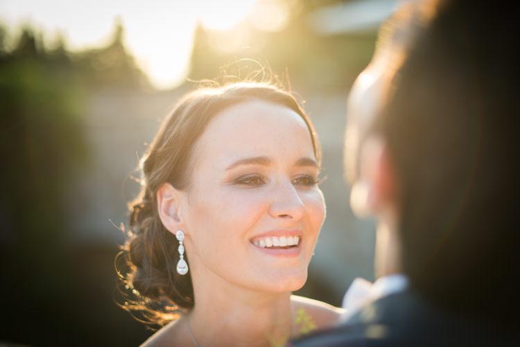 Bride Soft Bun Hairstyle Crystal Drop Earrings Groom Black Suit Sunset Romantic Outdoor Castle Tuscany Wedding http://www.natalymontanari.com/