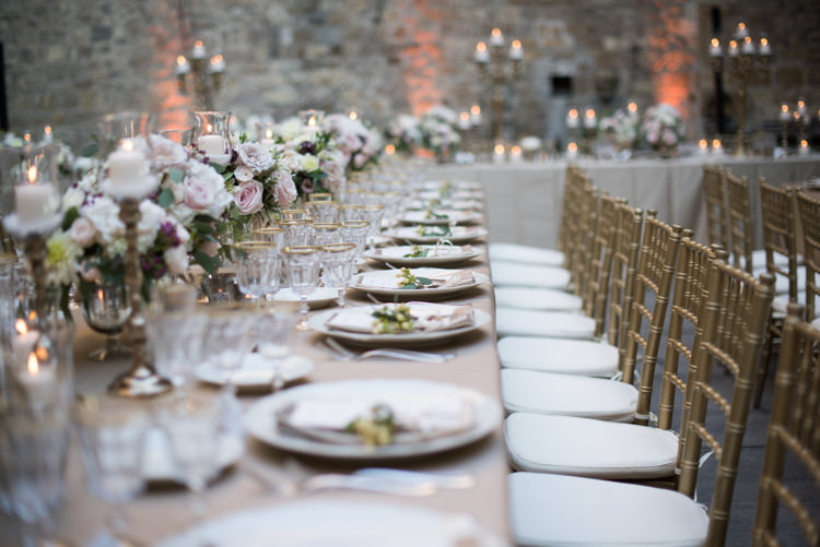 Reception Table Setting Fresh White Pink Purple Florals Roses Peonies Daisies Gold Candlesticks Gold Chairs Romantic Outdoor Castle Tuscany Wedding http://www.natalymontanari.com/