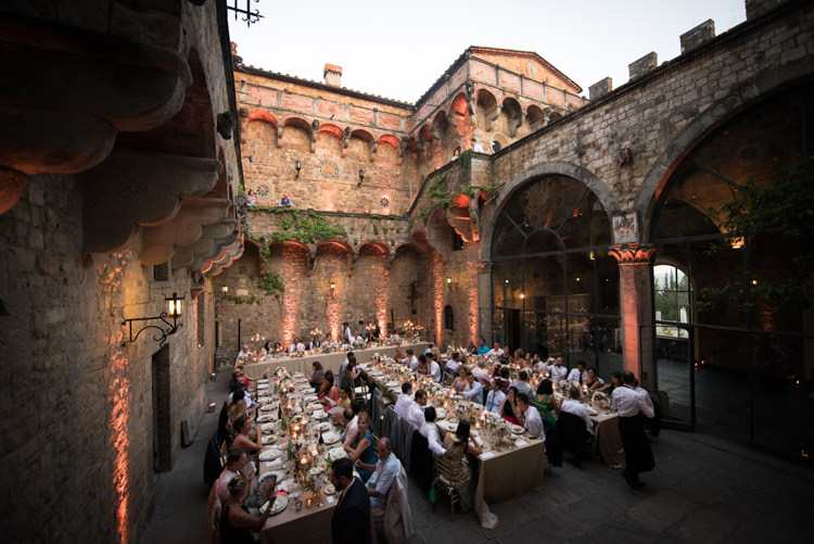 Reception Table Settings Gold Chairs Candlesticks Guests Sunset Romantic Outdoor Castle Tuscany Wedding http://www.natalymontanari.com/