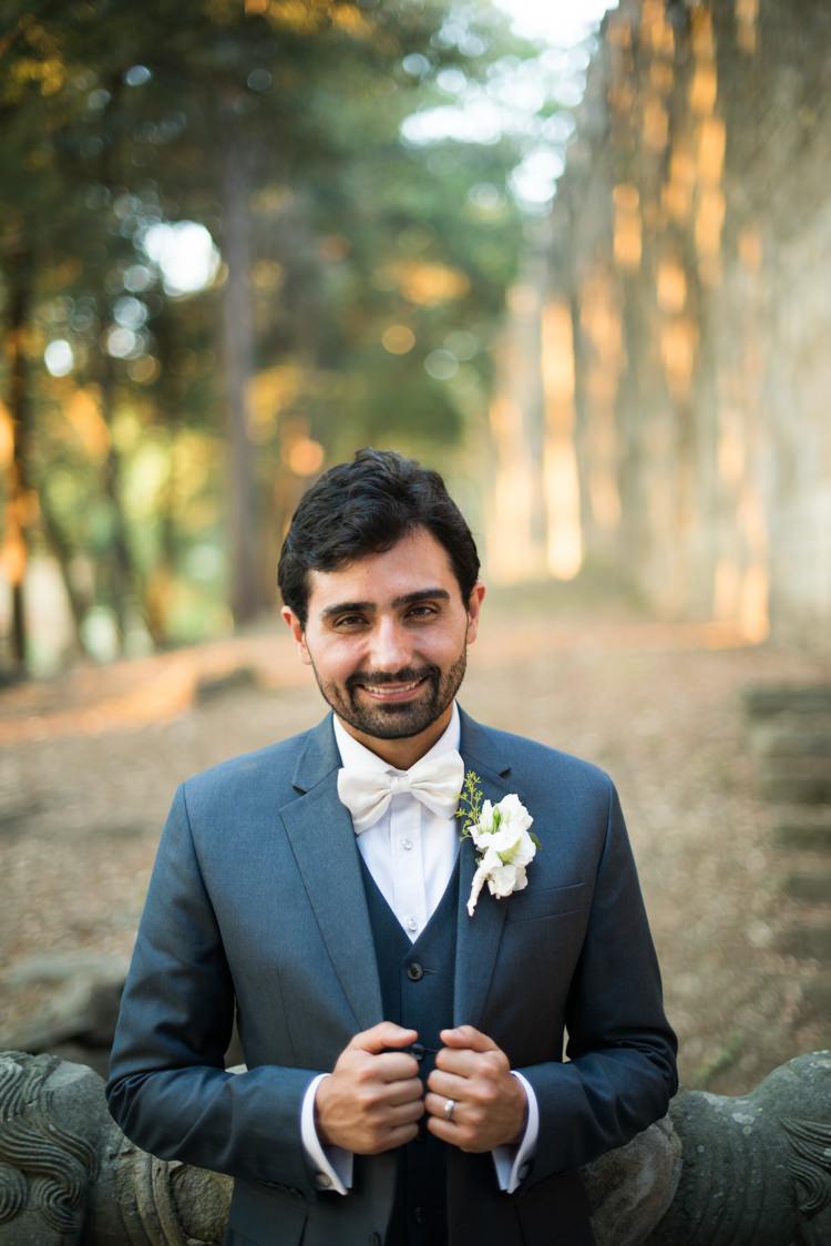 Groom Black Suit White Shirt White Bowtie White Floral Buttonhole Romantic Outdoor Castle Tuscany Wedding http://www.natalymontanari.com/
