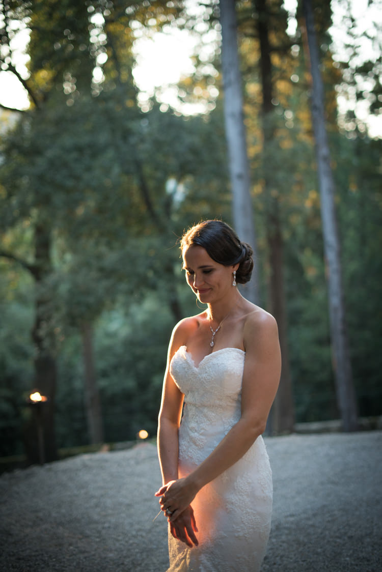 Bride Fitted Lace Mermaid Bridal Gown Soft Bun Hairstyle Crystal Earrings Necklace Romantic Outdoor Castle Tuscany Wedding http://www.natalymontanari.com/