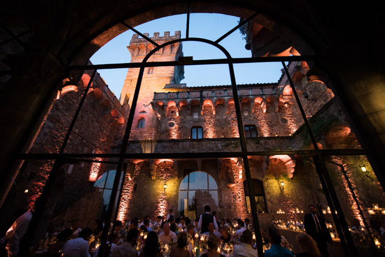 Reception Guests Candlelight Sunset Large Window Romantic Outdoor Castle Tuscany Wedding http://www.natalymontanari.com/
