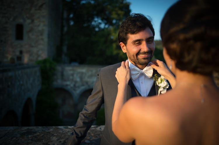 Sunset Groom Black Suit White Shirt White Bowtie White Floral Buttonhole Bride Romantic Outdoor Castle Tuscany Wedding http://www.natalymontanari.com/