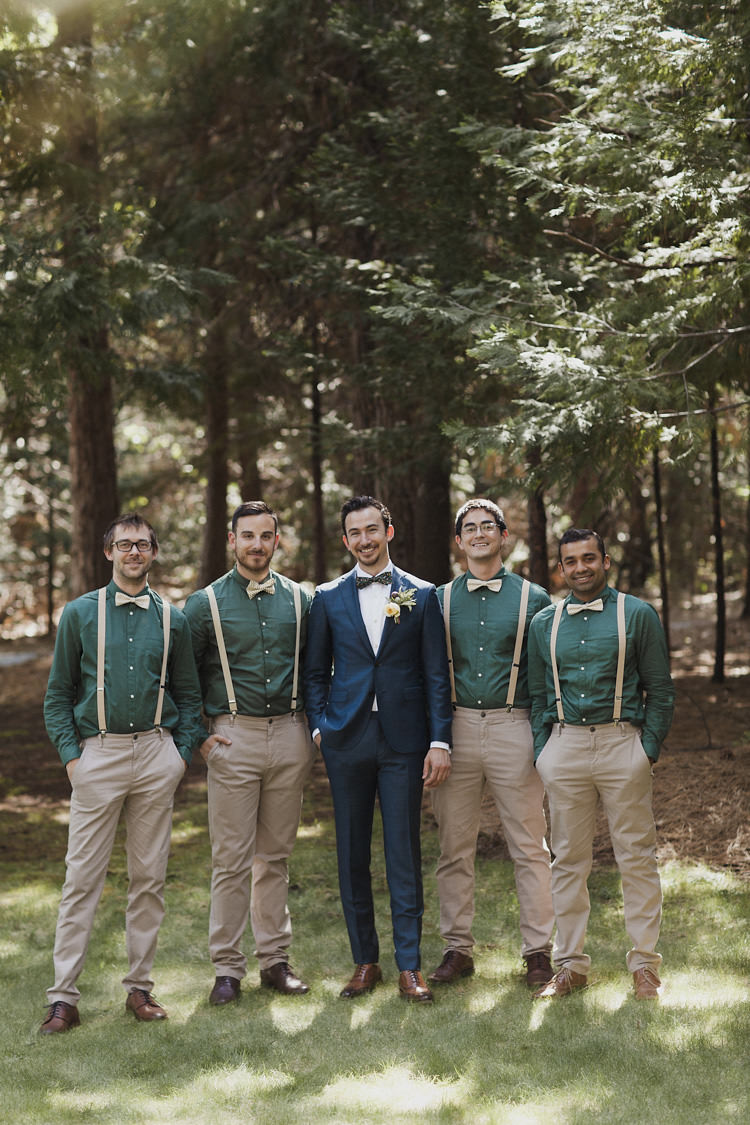 Groom Dark Blue Suit White Shirt Patterned Bowtie Floral Buttonhole Groomsmen Green Shirts Beige Pants Suspenders Bowties Whimsical Forest Harry Potter Wedding http://heatherelizabethphotography.com/
