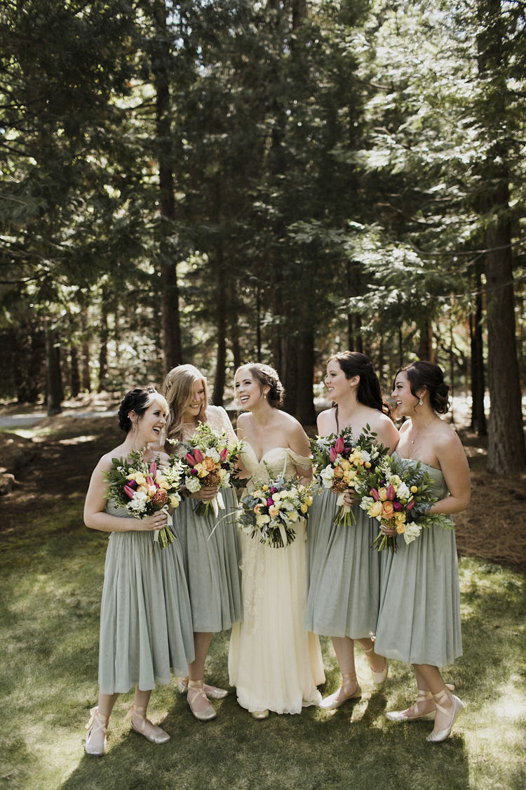 Bride Sarah Seven Cascade Off The Shoulder Lace Bridal Gown Bridesmaids Green Strapless Dresses Ballet Slippers Ribbons Multicoloured Bouquets Whimsical Forest Harry Potter Wedding http://heatherelizabethphotography.com/