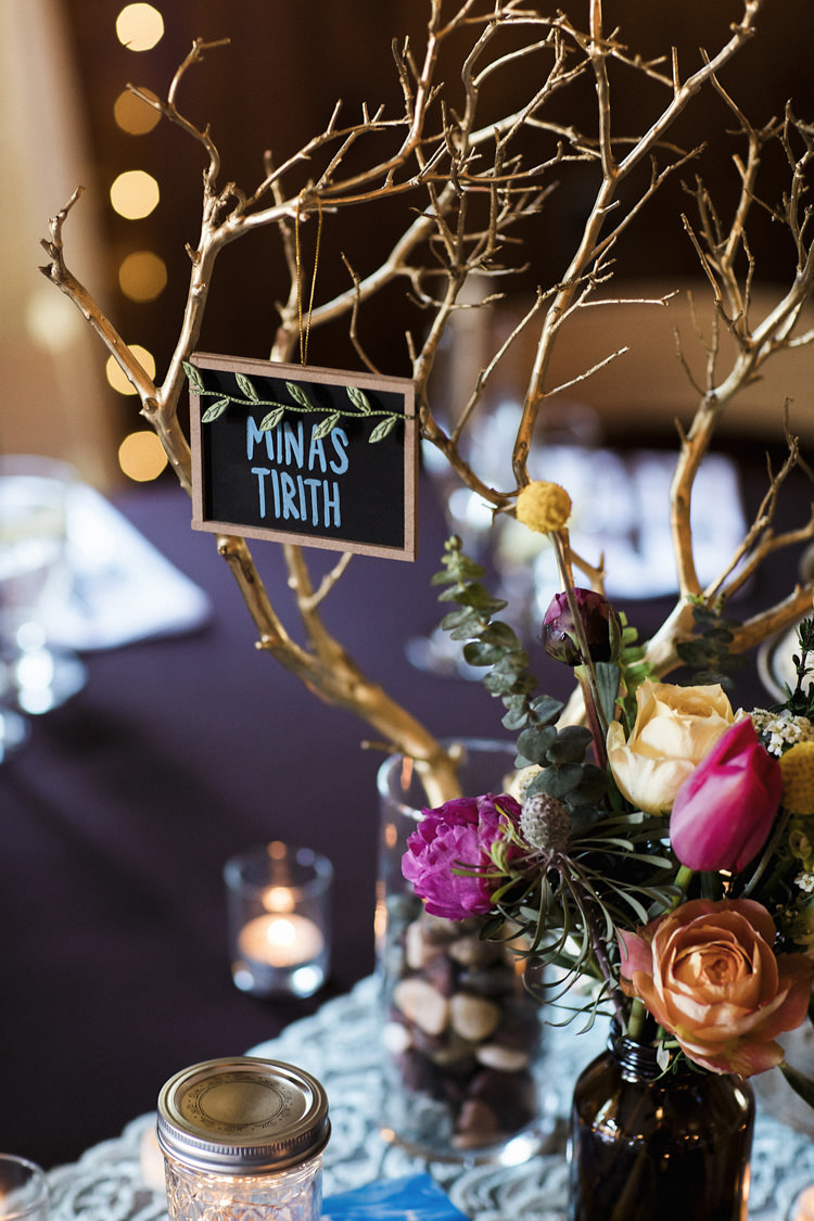 Reception Table Setting Book Lover Theme Painted Branches Blackboard Dark Bottle Multicoloured Florals Candles Whimsical Forest Harry Potter Wedding http://heatherelizabethphotography.com/