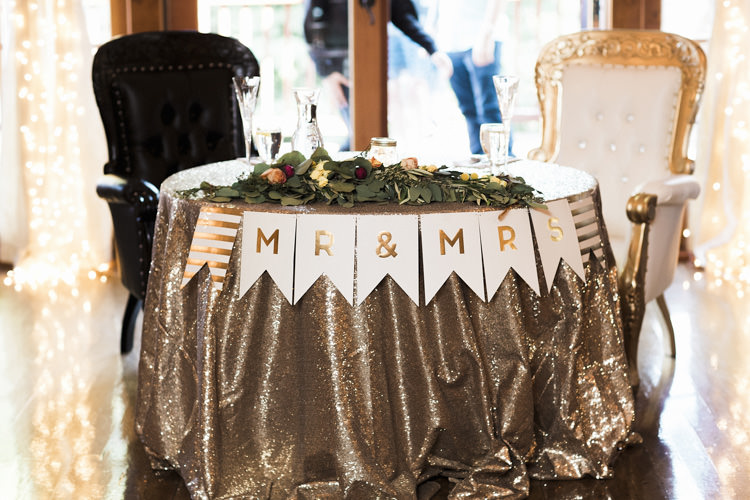 Reception Table Setting Bride Groom Table Metallic Sequin Tablecloth Mr Mrs Bunting Florals Greenery Vintage Chairs Whimsical Forest Harry Potter Wedding http://heatherelizabethphotography.com/