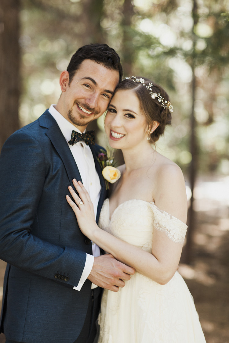 First Look Bride Sarah Seven Cascade Lace Off The Shoulder Bridal Gown Embellished Belt Crystal Hairpiece Groom Dark Blue Suit Patterned Bowtie Floral Buttonhole Whimsical Forest Harry Potter Wedding http://heatherelizabethphotography.com/