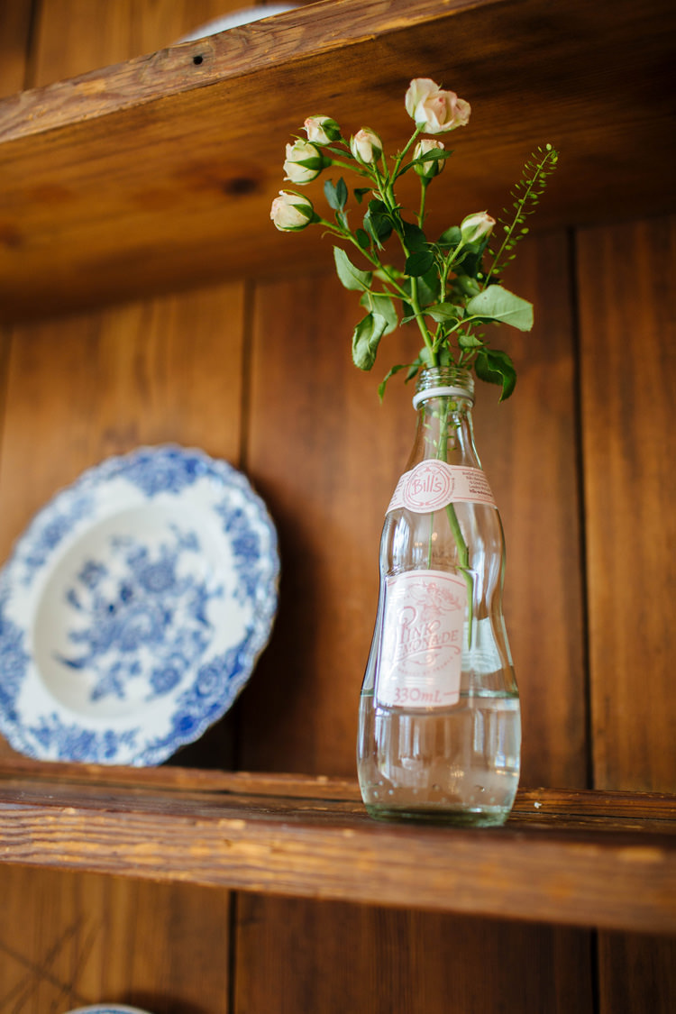 Bottle Flowers Dresser Enchanted English Country Garden Wedding Disney http://lauradebourdephotography.com/