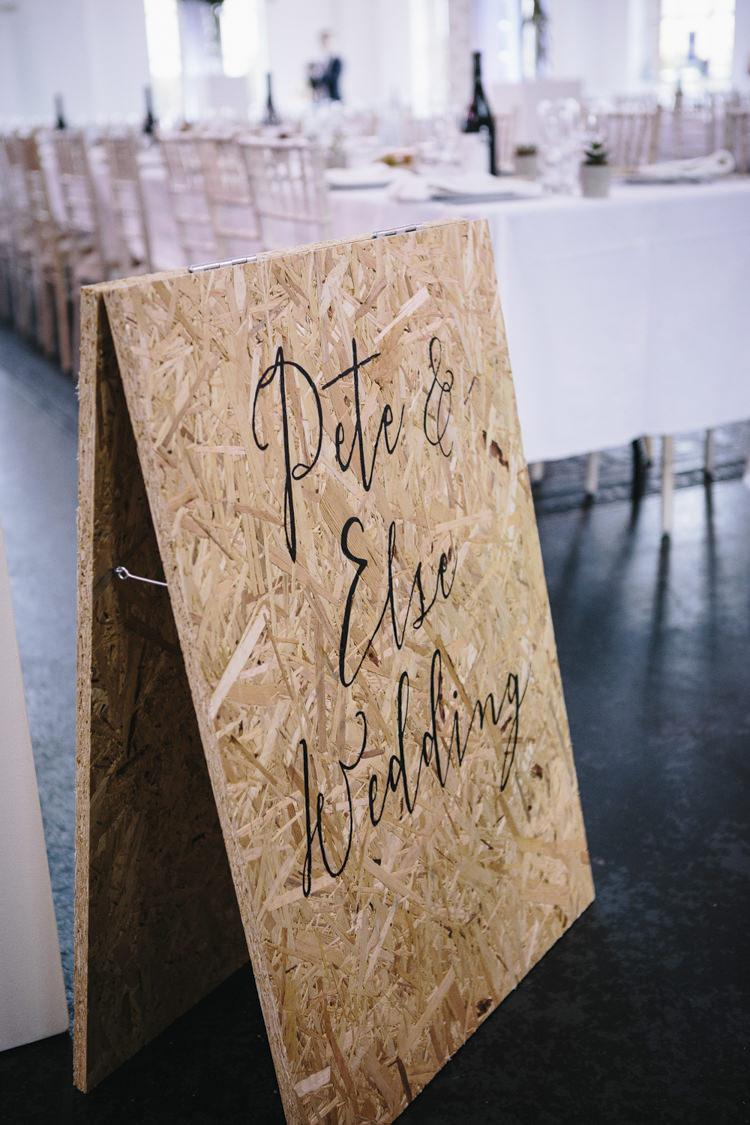 Wooden Board Calligraphy Sign Stylish Clean Modern City Wedding https://mybeautifulbride.co.uk/