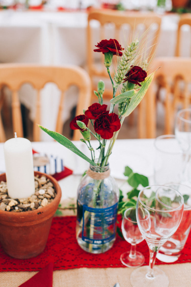 Red Flowers Wheat Bottle Centrepiece Decor Hand Made Red White Blue Farm Wedding http://www.caseyavenue.co.uk/