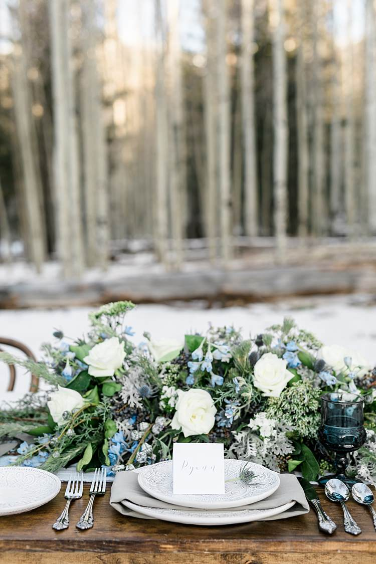 Outdoor Reception Wooden Table Setting Calligraphy Name Card Fresh White Blue Green Florals Roses Snowy Winter Wonderland Anniversary Shoot http://ryannlindseyphotography.com/