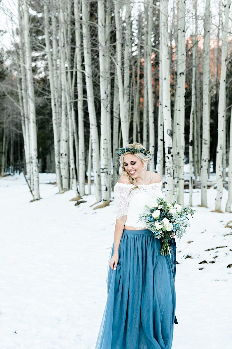 Bride White Lace Off The Shoulder Top Blue Long Skirt Floral Crown Bouquet White Blue Green Flowers Snowy Winter Wonderland Anniversary Shoot http://ryannlindseyphotography.com/