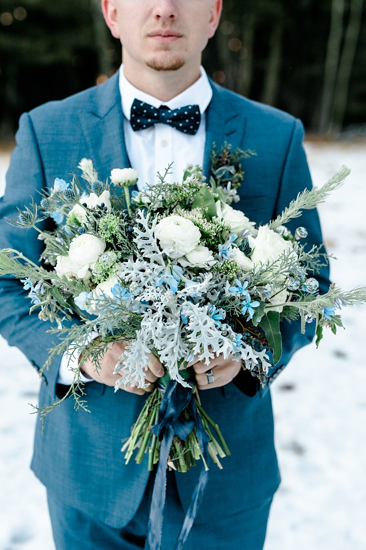 Groom Blue Suit Navy Polka Dot Bowtie Bridal Bouquet White Blue Green Flowers Blue Ribbon Snowy Winter Wonderland Anniversary Shoot http://ryannlindseyphotography.com/