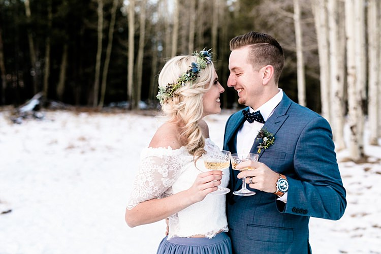 Bride Lace Off The Shoulder Top Blue Long Skirt Floral Crown Bouquet White Blue Green Flowers Groom Blue Suit Navy Polka Dot Bowtie Cocktails Snowy Winter Wonderland Anniversary Shoot http://ryannlindseyphotography.com/