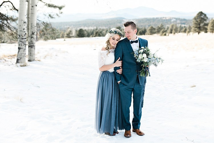 Bride Lace Off The Shoulder Top Blue Long Skirt Floral Crown Bouquet White Blue Green Flowers Groom Blue Suit Navy Polka Dot Bowtie Brown Leather Shoes Snowy Winter Wonderland Anniversary Shoot http://ryannlindseyphotography.com/