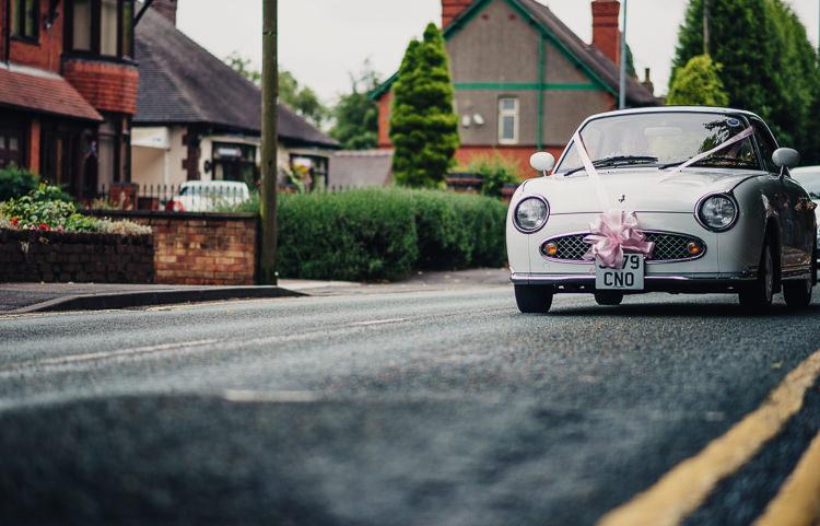 Nissan Figaro Car Transport Quirky Crafty Rustic Barn Wedding http://www.stevebridgwoodphotography.co.uk/