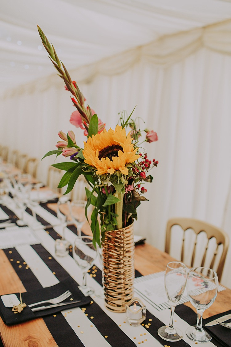 Tall Gold Vase Centrepiece Flowers Sunflower Colourful Indie Dinosaur Wedding http://bloomweddings.co.uk/