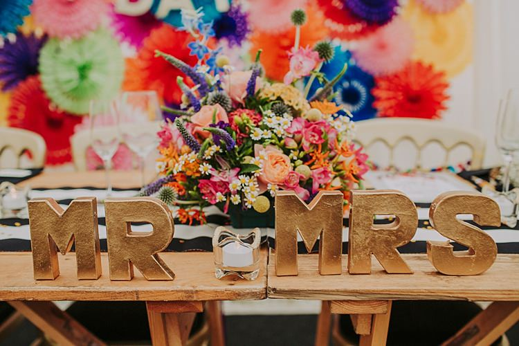 MR MRS Sign Table Decor Top Colourful Indie Dinosaur Wedding http://bloomweddings.co.uk/