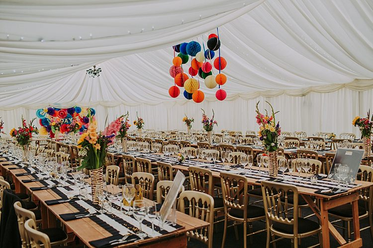 Rainbow Marquee Decor Colourful Indie Dinosaur Wedding http://bloomweddings.co.uk/