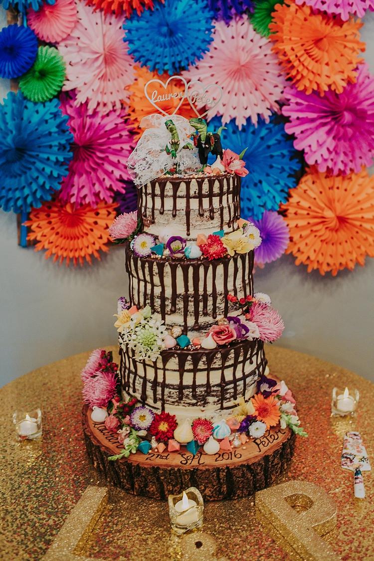 Cake Naked Buttercream Drip Meringues Flowers Log Colourful Indie Dinosaur Wedding http://bloomweddings.co.uk/