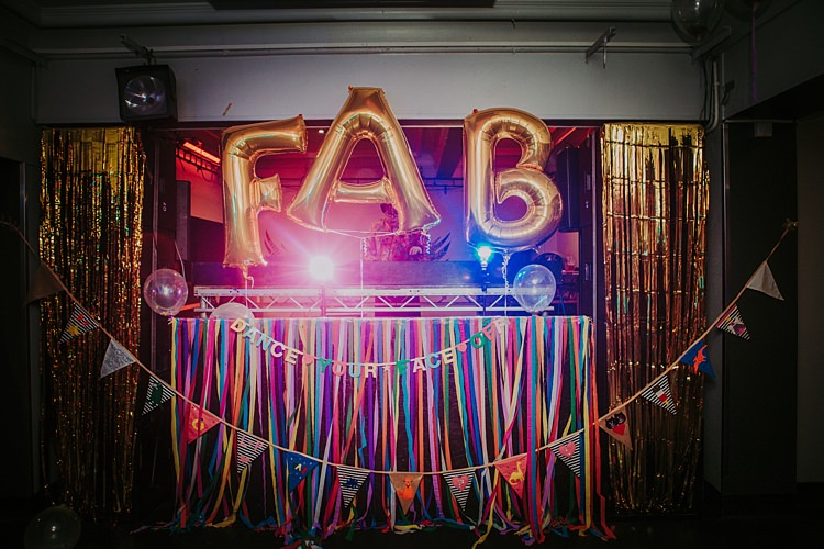 DJ Booth Ribbons Streamers Colourful Indie Dinosaur Wedding http://bloomweddings.co.uk/