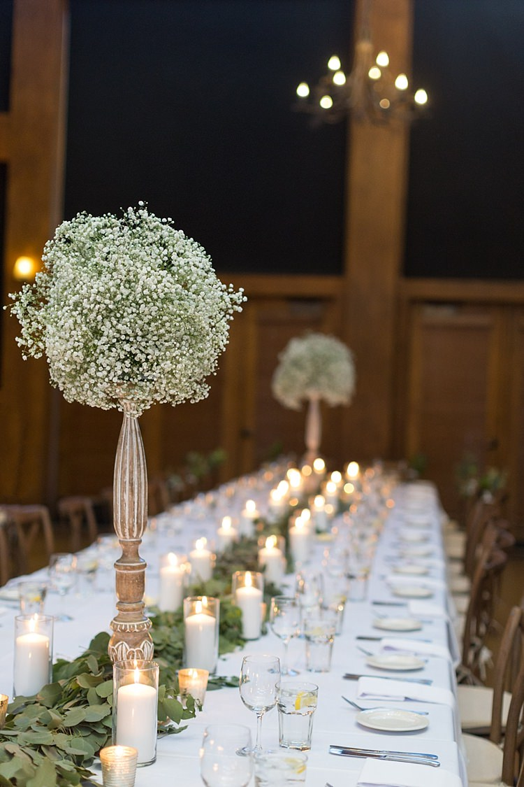 Reception Table Setting Tall Vases Gypsophila Green Leaves Candles Romantic Mountain Wedding Colorado http://irvingphotographydenver.com/