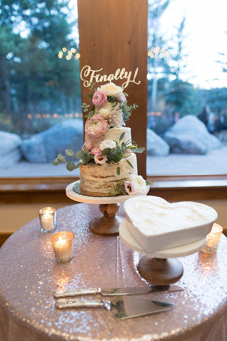 Reception Naked Wedding Cake Pale Pink Florals Finally Cake Topper Wooden Stand Love Heart White Cake Sequinned Tablecloth Candles Romantic Mountain Wedding Colorado http://irvingphotographydenver.com/