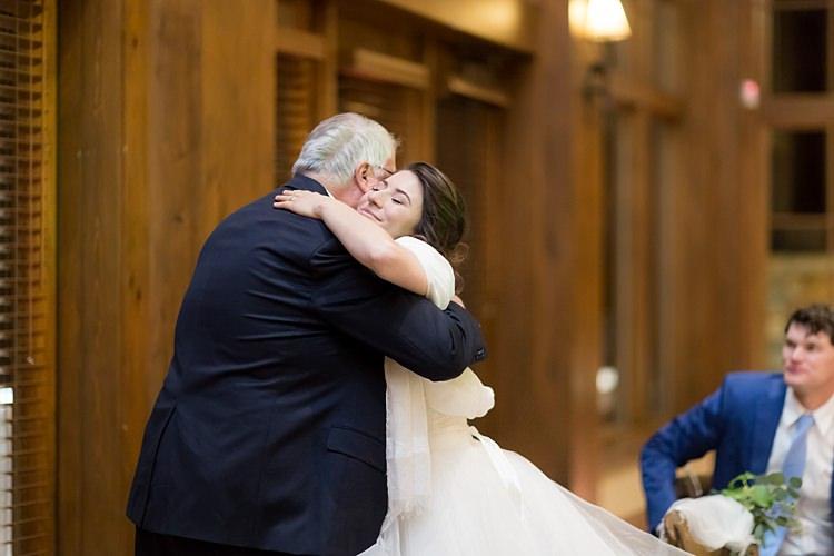 Reception Bride Strapless Lace Ballgown Bridal Gown Hugs Groom Blue Suit White Shirt Light Blue Tie Romantic Mountain Wedding Colorado http://irvingphotographydenver.com/