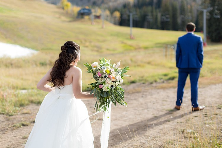 Outdoor First Look Bride Strapless Lace Ballgown Bridal Gown Bouquet Multicoloured Pastel Roses Peonies Anemones Greenery Florals Groom Blue Suit Romantic Mountain Wedding Colorado http://irvingphotographydenver.com/