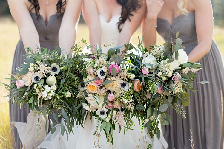 Bride Strapless Lace Ballgown Bridal Gown Bridesmaids Grey Strapless Dresses Bouquets Multicoloured Pastel Roses Peonies Anemones Greenery Florals Romantic Mountain Wedding Colorado http://irvingphotographydenver.com/