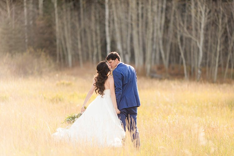 Bride Strapless Lace Ballgown Bridal Gown Bouquet Multicoloured Pastel Roses Peonies Anemones Greenery Groom Blue Suit Romantic Mountain Wedding Colorado http://irvingphotographydenver.com/