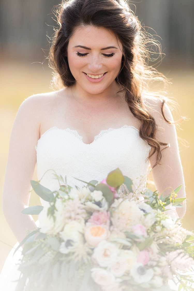 Bride Strapless Lace Ballgown Bridal Gown Bouquet Multicoloured Pastel Roses Peonies Anemones Greenery Loose Curls Hairstyle Soft Makeup Romantic Mountain Wedding Colorado http://irvingphotographydenver.com/
