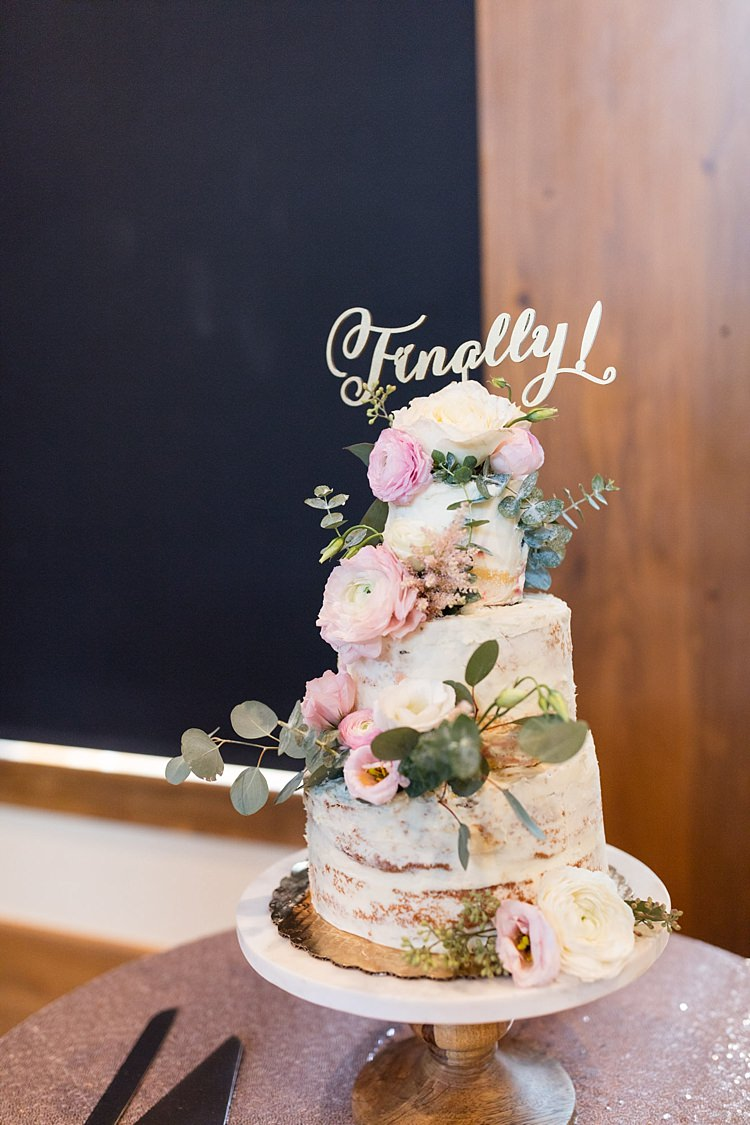 Reception Naked Wedding Cake Pale Pink Florals Greenery Finally Cake Topper Wooden Stand Sequinned Tablecloth Romantic Mountain Wedding Colorado http://irvingphotographydenver.com/