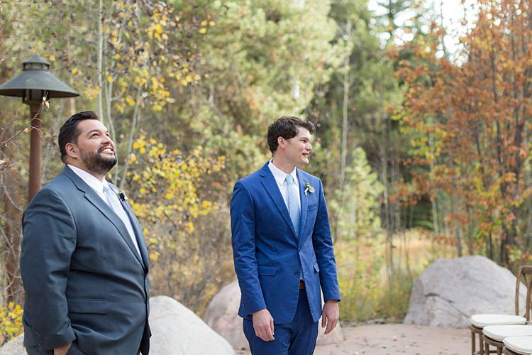 Outdoor Ceremony Groom Blue Suit White Shirt Light Blue Tie Autumn Trees Romantic Mountain Wedding Colorado http://irvingphotographydenver.com/