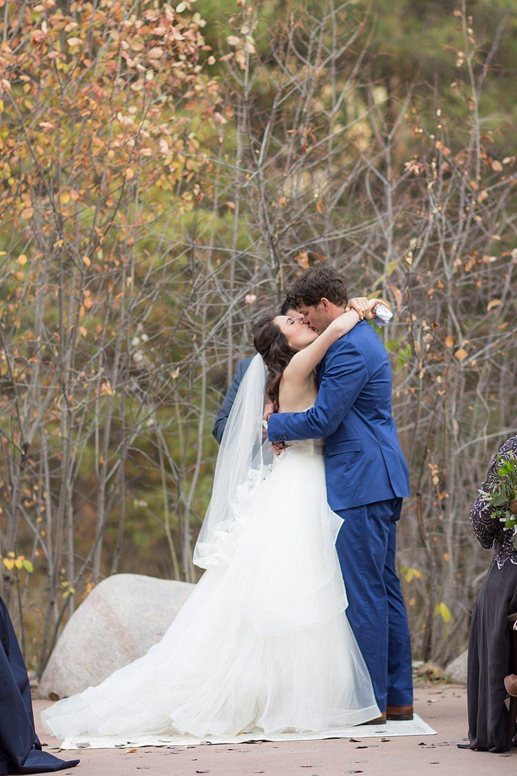 Outdoor Ceremony Bride Strapless Lace Ballgown Bridal Gown Veil Groom Blue Suit Tan Shoes The Kiss Autumn Trees Romantic Mountain Wedding Colorado http://irvingphotographydenver.com/