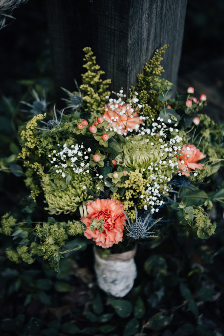 Bouquet Fresh Florals Orange Carnation Thistle Gypsophila Lace Ribbon Adventure Inspired Woodland Wedding North Carolina http://www.amandasuttonphotography.com/