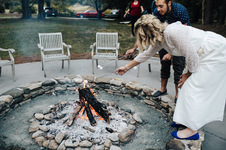 Reception Outdoor S'mores Station Bride Handmade Lace Bridal Gown Blue Shoes Guests Adventure Inspired Woodland Wedding North Carolina http://www.amandasuttonphotography.com/