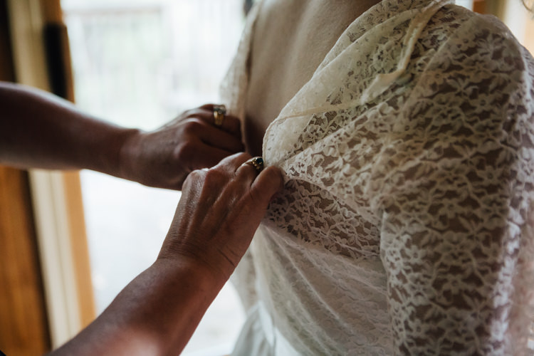 Bride Getting Ready Handmade Lace Floral Belt Bridal Gown Adventure Inspired Woodland Wedding North Carolina http://www.amandasuttonphotography.com/