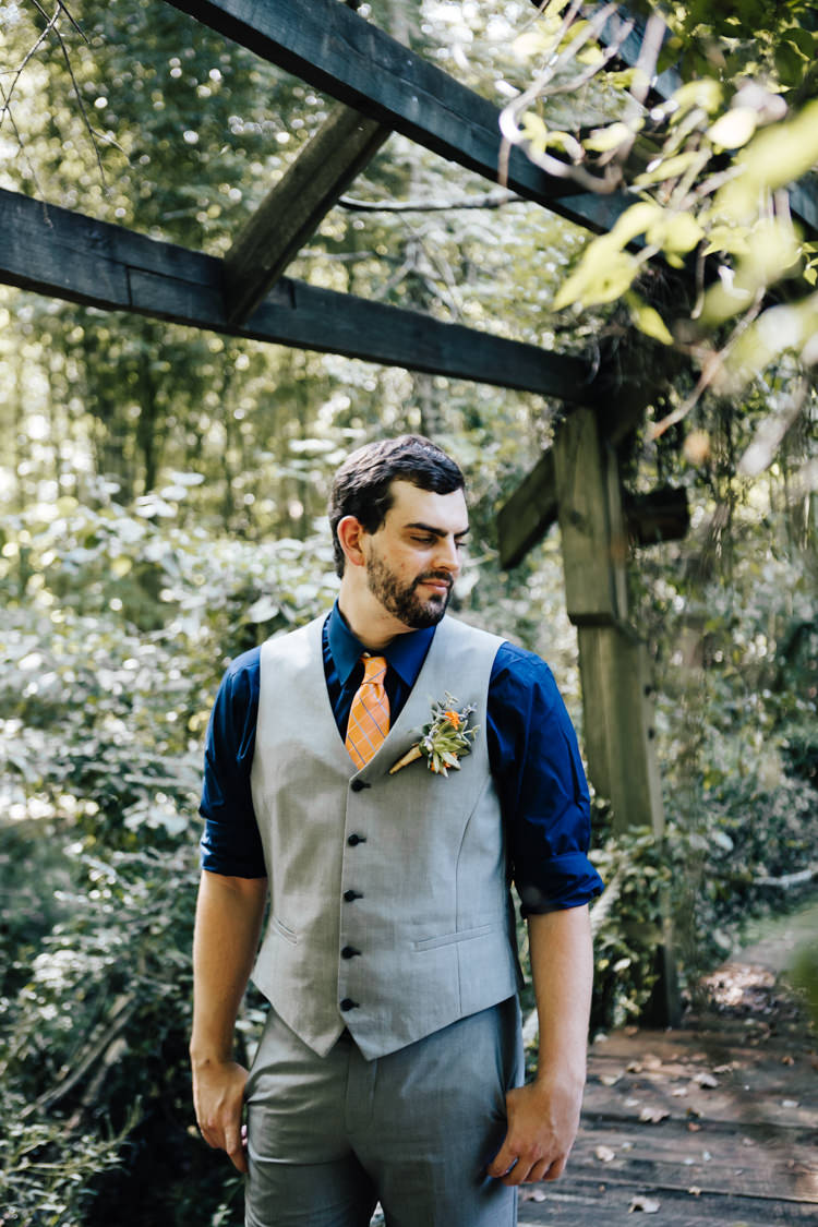 Groom Grey Vest Pants Navy Blue Shirt Orange Checkered Tie Buttonhole Orange Florals Greenery Succulent Adventure Inspired Woodland Wedding North Carolina http://www.amandasuttonphotography.com/