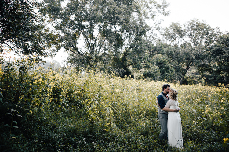 Bride Handmade Lace Bridal Gown Groom Grey Vest Pants Navy Blue Shirt Yellow Flowers Adventure Inspired Woodland Wedding North Carolina http://www.amandasuttonphotography.com/