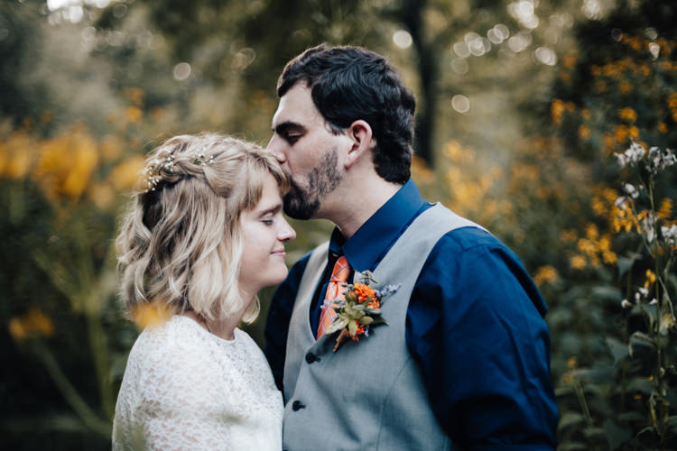 Bride Handmade Lace Floral Belt Bridal Gown Groom Grey Vest Pants Navy Blue Shirt Orange Checkered Tie Buttonhole Orange Florals Greenery Succulent Yellow Flowers Adventure Inspired Woodland Wedding North Carolina http://www.amandasuttonphotography.com/
