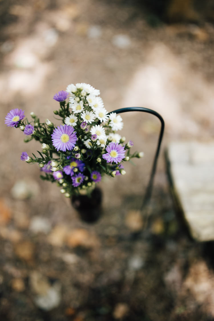 Outdoor Ceremony Fresh Florals Purple White Beer Bottle Wooden Bench Seating Adventure Inspired Woodland Wedding North Carolina http://www.amandasuttonphotography.com/