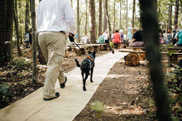 Outdoor Ceremony Dog Ring Bearer Guests Wooden Benches Adventure Inspired Woodland Wedding North Carolina http://www.amandasuttonphotography.com/