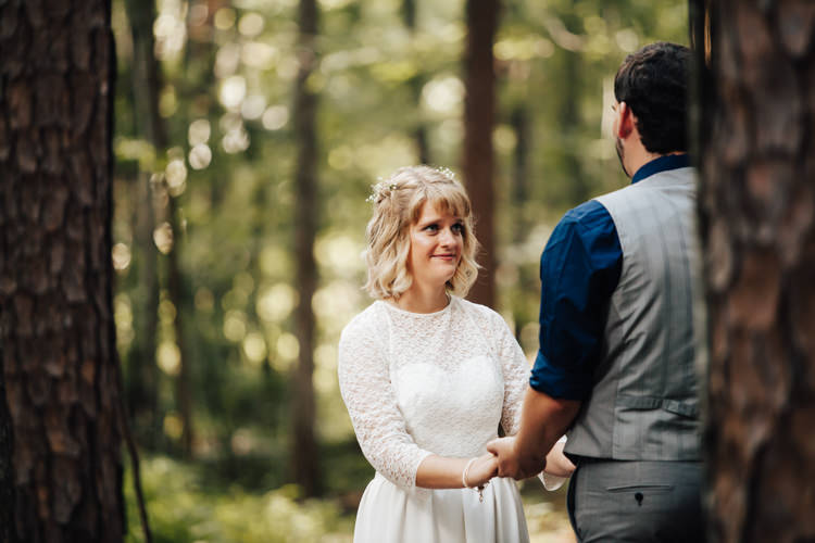 Outdoor Ceremony Bride Handmade Lace Bridal Gown Groom Grey Vest Pants Navy Blue Shirt Adventure Inspired Woodland Wedding North Carolina http://www.amandasuttonphotography.com/