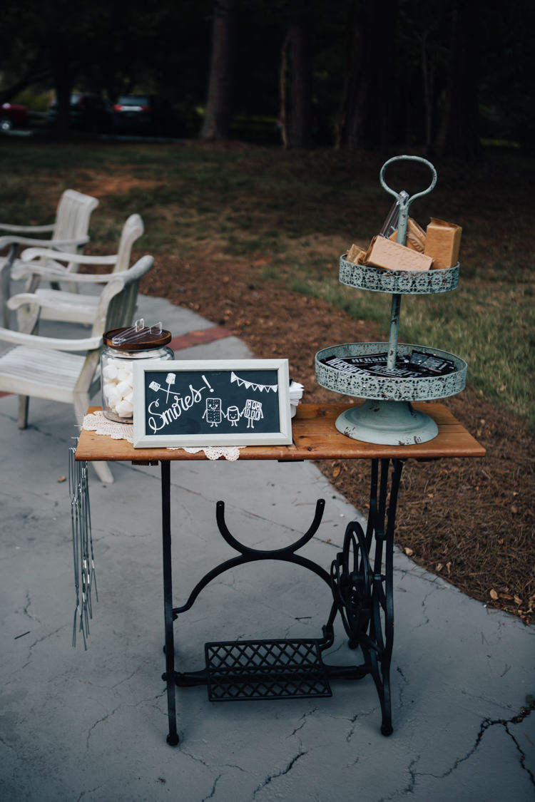 Reception Outdoor S'mores Station Antique Sewing Table Blackboard Sign Adventure Inspired Woodland Wedding North Carolina http://www.amandasuttonphotography.com/