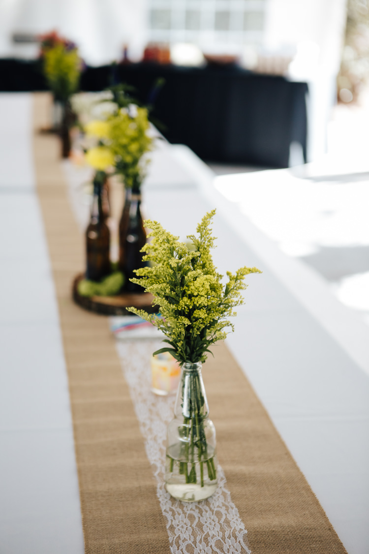 Reception Table Setting Hessian Lace Table Runner Glass Beer Bottle Vases Fresh Florals Wood Slice Adventure Inspired Woodland Wedding North Carolina http://www.amandasuttonphotography.com/