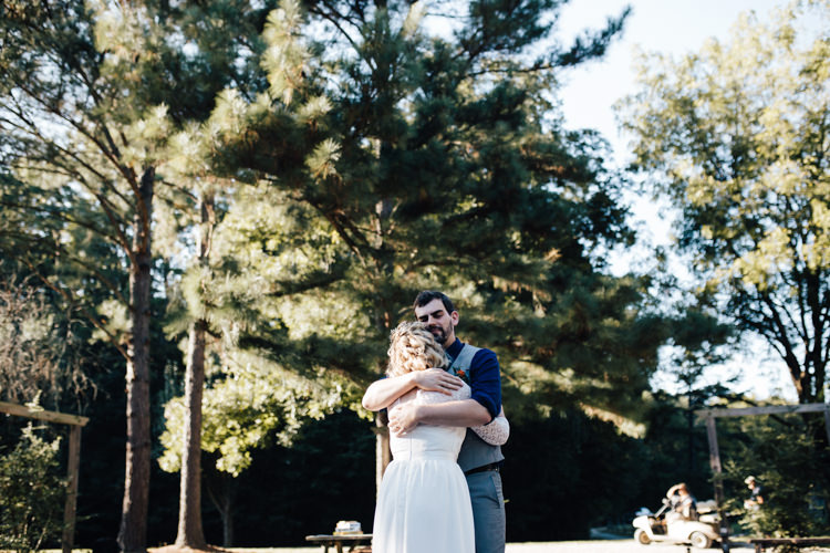 Bride Handmade Lace Bridal Gown Groom Grey Vest Pants Navy Blue Shirt Orange Checkered Tie Adventure Inspired Woodland Wedding North Carolina http://www.amandasuttonphotography.com/