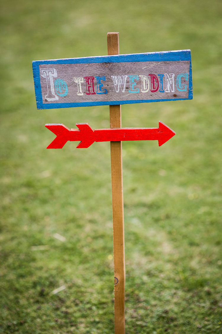 Rustic Wooden Sign Post Circus Colourful Vintage Comic Book Wedding Ideas http://www.hayleypettitphotography.com/